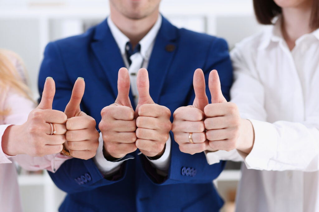 Group Of People Show Ok Or Approval With Thumb Up During Confere